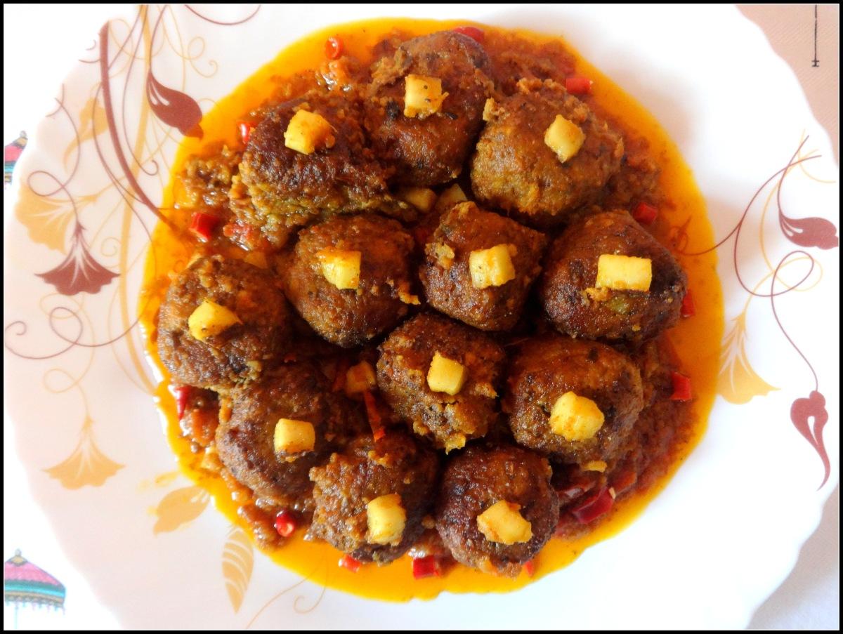 Fried Banana flower dumplings in spicy gravy (Mochar Kofta Curry)