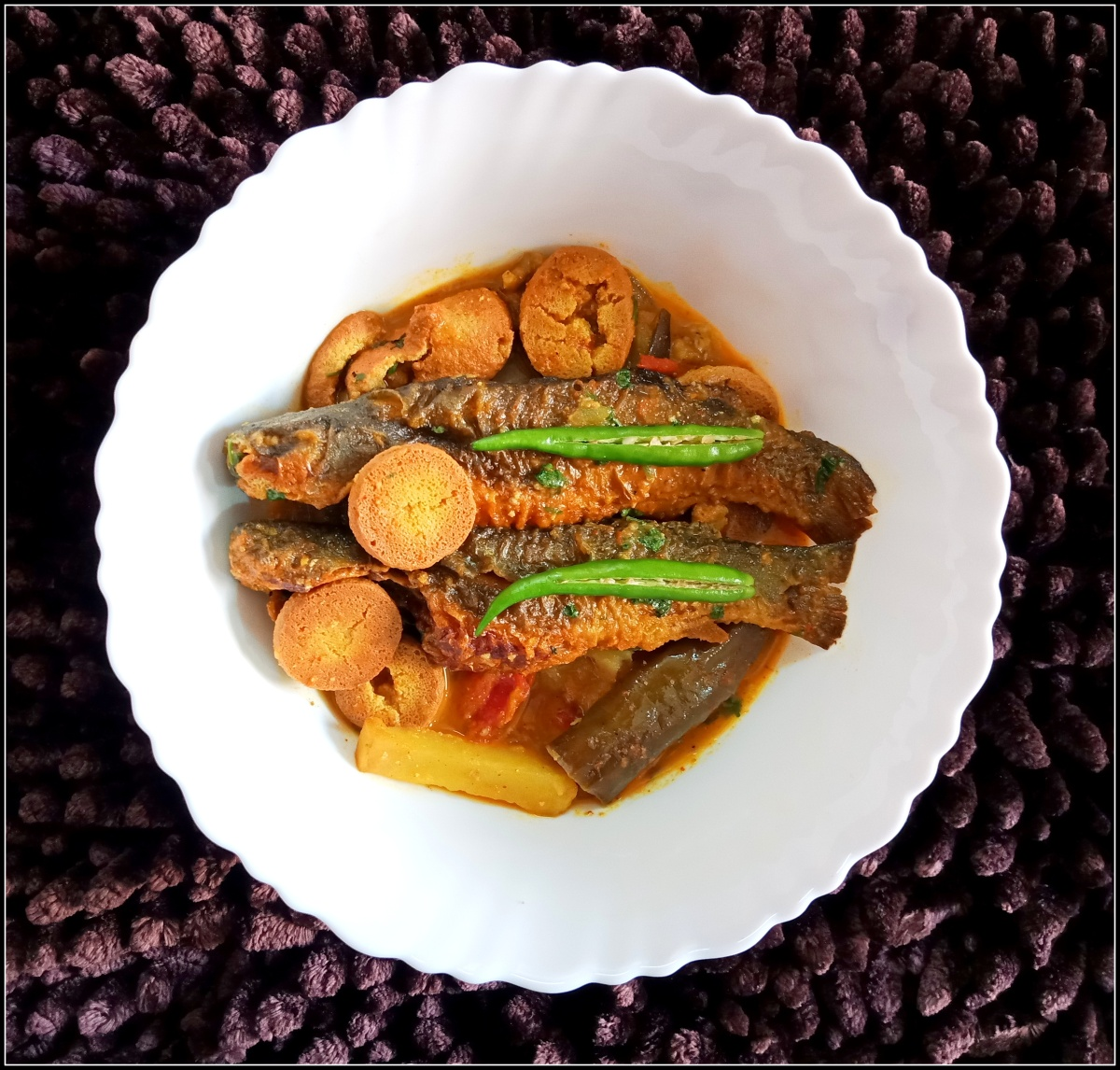 Freshwater Catfish curry (Aloo Begun Bori diye Tangra Macher Jhol)